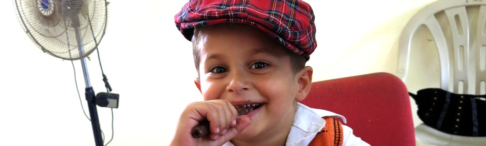 Young boy in Yatma with tartan cap